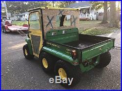 2004 JOHN DEERE GATOR 6X4 DIESEL WITH ENCLOSED CAB AND DUMP BODY(gov't surplus)